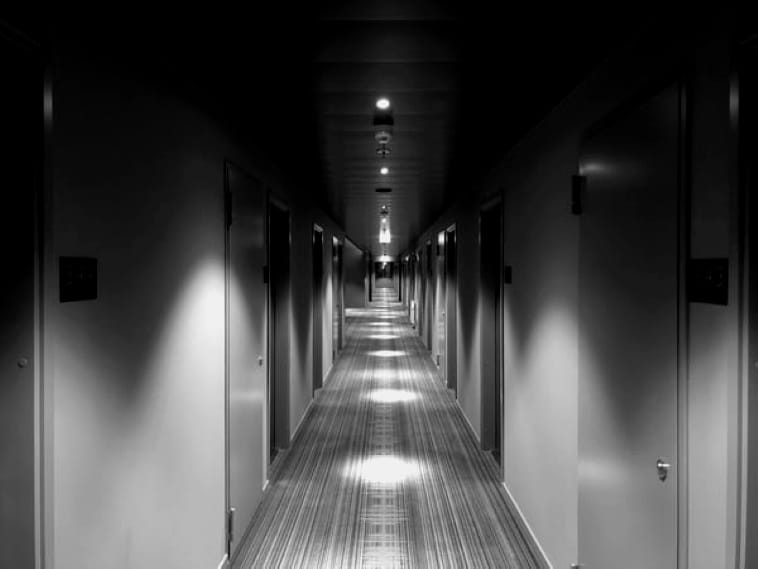 a poem by Tricia McCallum. April 10,. 2020. A long apartment hallway, dimly lit.