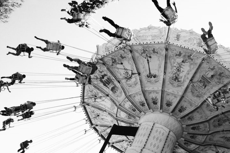 A poem by Tricia McCallum March 27 2020. A spinning carousel at a midway.