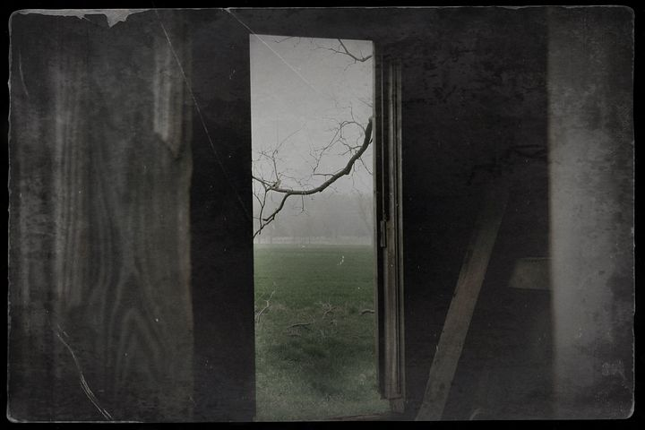A poem by Tricia McCallum called Captive Audience. A bleak doorway facing out to a barren vista