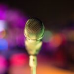 grey microphone with lights in bokeh photography