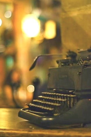 A poem by Tricia McCallum. Photo of vintage typewriter.