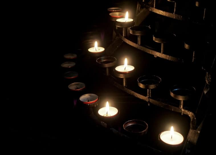 a poem by Tricia McCallum March 26, 2020 - candle votives flickering in rows.